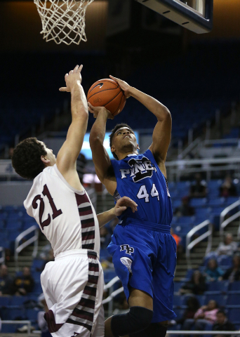 Desert Pines' Trevon Abdullah shoots past Elko defender Nathan Klekas in the Division I-A state semifinals. Elko won 63-47 to advance to the state championship game. (Cathleen Allison/Las Vegas Re ...