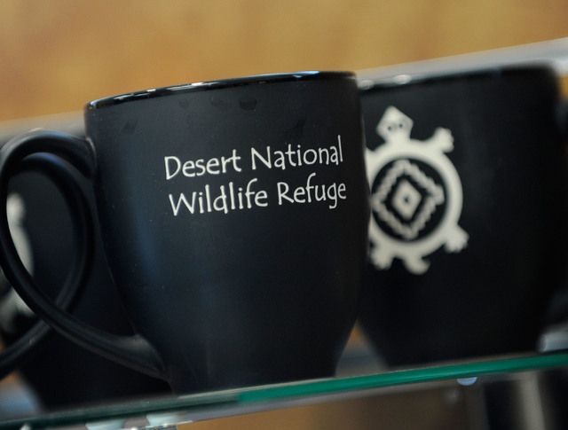 Souvenirs are on display and for sale in the gift shop of the newly open visitor center at the Desert National Wildlife Refuge on Dec. 29, 2013. The public grand opening of the new Corn Creek visi ...