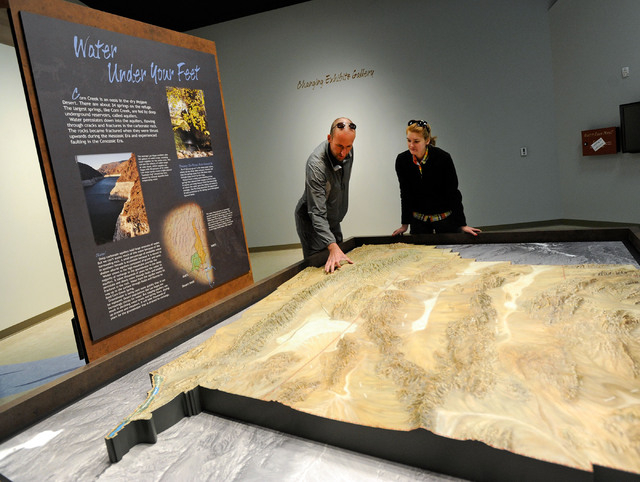 Brandon Lindsey, left, and Marisa Peterson examine a relief map inside the newly open visitor center at the Desert National Wildlife Refuge on Dec. 29, 2013.The public grand opening of the new Cor ...