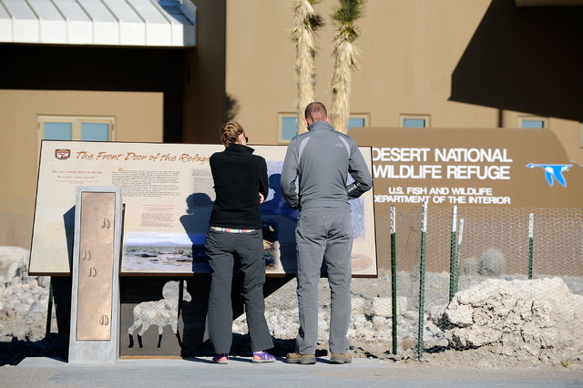 Marisa Peterson, left, and Brandon Lindsey examine at one of the many information displays at the newly open visitor center at the Desert National Wildlife Refuge on Dec. 29, 2013.The public grand ...