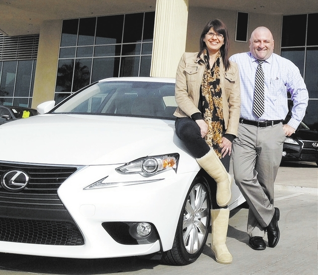 Courtesy photo Cathy Grusinski purchased a 2014 Lexus IS 250 from Lexus of Henderson sales and leasing agent Gary Kanadjian.