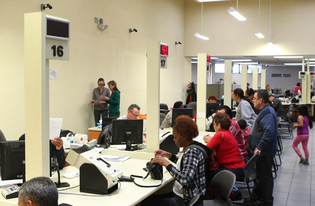 People are assisted at the DMV office at 2701 E. Sahara Ave in Las Vegas on Friday, Jan. 3, 2014. (Chase Stevens/Las Vegas Review-Journal)