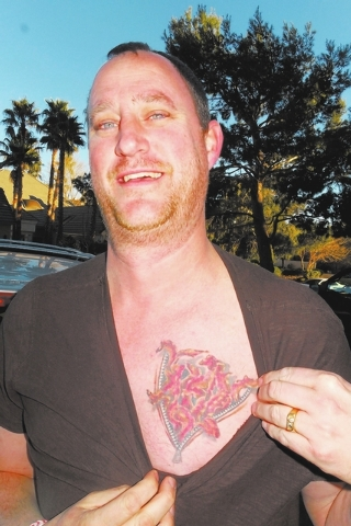 "Norm Clarke/Las Vegas Review-Journal Geoff Renne, or ""Mr. Bacon,"" shows off his bacon heart tattoo and ""BACONMN"" license plate."