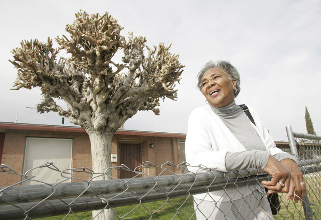 CRAIG L. MORAN/LAS VEGAS REVIEW-JOURNAL News-- Agnes Marshall, age 78, stands in front of her home located at 1666 D. St in the Berkley Square neighborhood Monday November 23, 2009. Marshall has o ...
