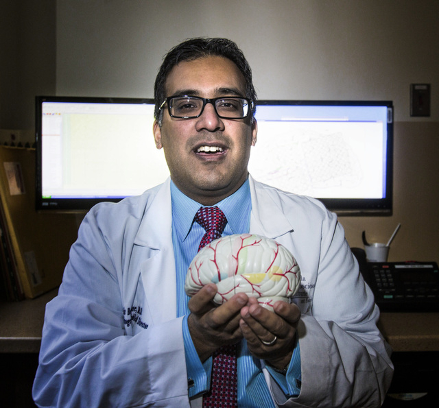 Dr. Samir Bangalore,medical director of the Epilepsy Center at Nevada Neurosciences Institute of Sunrise Health, in a monitoring room at the hospital, Monday, Feb. 3, 2014. This is the only facili ...