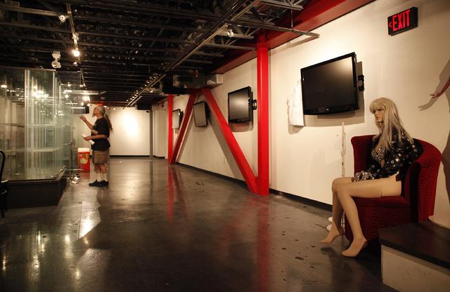 Jerry Zientara packs up items at the Erotic Heritage Museum in Las Vegas Thursday, Feb. 20, 2014. The museum has closed down. (John Locher/Las Vegas Review-Journal)