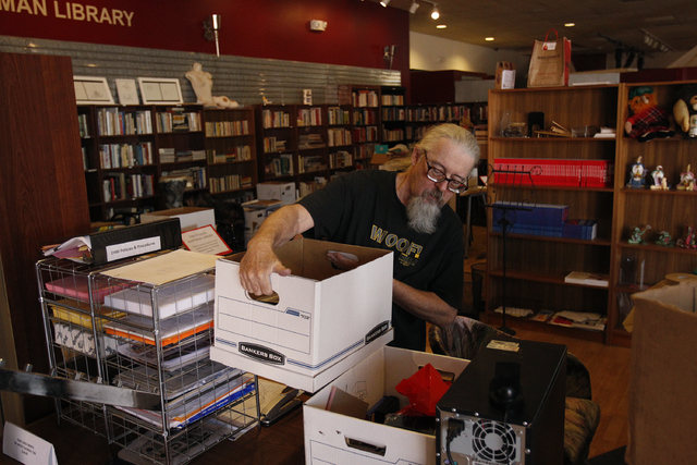Jerry Zientara packs up items at the Erotic Heritage Museum in Las Vegas Thursday, Feb. 20, 2014. The museum has closed down. (John Locher/Las Vegas Review-Journal)