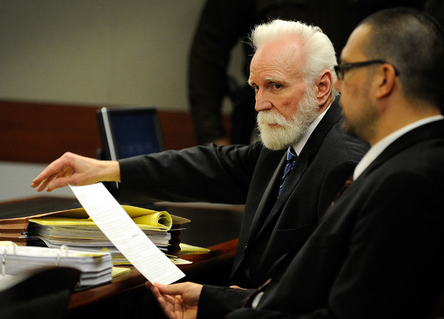 Certified nursing assistant Steven Farmer, left, sits with one of his public defenders, Jeff Maningo, during his trial at the Regional Justice Center on Monday, Feb. 10. Farmer is accused of sexua ...