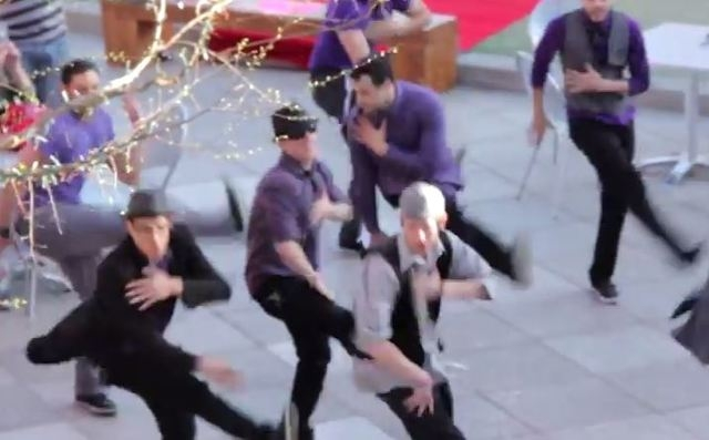A flash mob proposal was caught on camera Wednesday in the Container Park. (Downtown Podcast/YouTube)