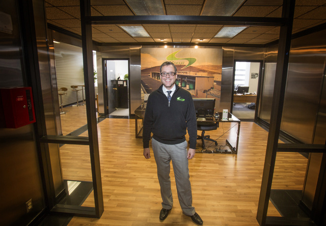 Peter Gunnerman, partner with GDiesel in his Reno office on Thursday, Dec. 19, 2013. The company manufactures an alternative fuel that blends natural gas and diesel fuel. Transportation officials  ...