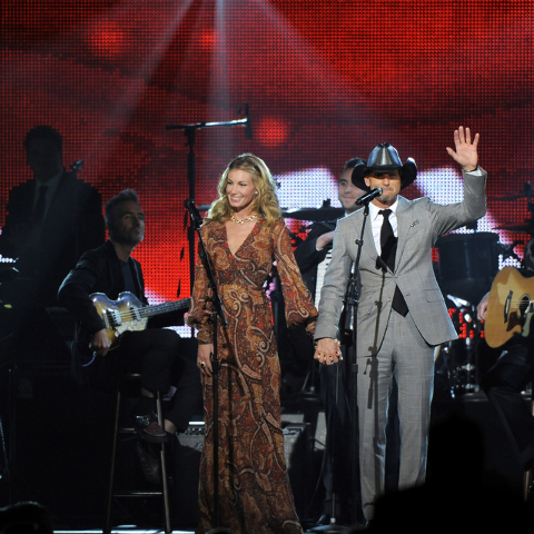 "Faith Hill, left, and Tim McGraw perform ""Tougher Than the Rest"" on stage at the MusiCares Person of the Year tribute honoring Bruce Springsteen at the Los Angeles Convention Center on Feb. 8. (Ph ..."