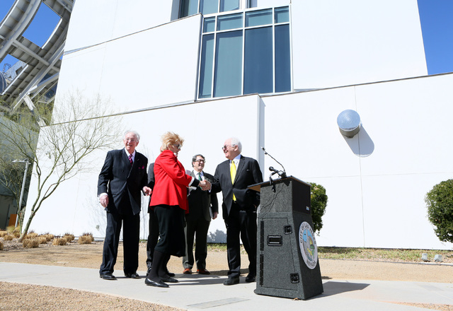 Mayor Carolyn Goodman, second from left, shakes hands with United States Conference of Mayors CEO & Executive Director Tom Cochran during a news conference outside the Cleveland Clinic Lou Ruvo Ce ...