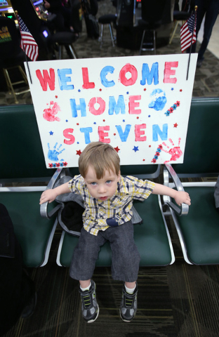 Jace Waddell, 19-months, of Gardnerville, was among the 300 family, friends and supporters on hand to greet Nevada Army Guard soldiers at the Reno-Tahoe International Airport in Reno, Nev., on Sun ...