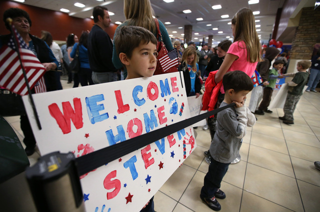 Chris and Kaden Waddell, 7 and 5, of Gardnerville, were among the 300 family, friends and supporters on hand to greet Nevada Army Guard soldiers at the Reno-Tahoe International Airport in Reno, Ne ...