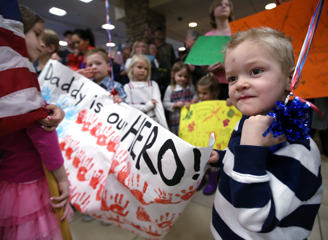 Jack Harrison, 4, waits for his father, Lt. Nigel Harrison to arrive at the Reno-Tahoe International Airport in Reno, Nev., on Sunday, Feb. 16, 2014. About 300 supporters greeted members of the Ne ...