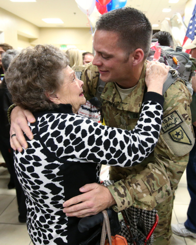 Chief Warrant Officer II Josh Groth hugs his grandmother Clo Groth as he and fellow Nevada Army Guard soldiers arrive at the Reno-Tahoe International Airport in Reno, Nev., on Sunday, Feb. 16, 201 ...