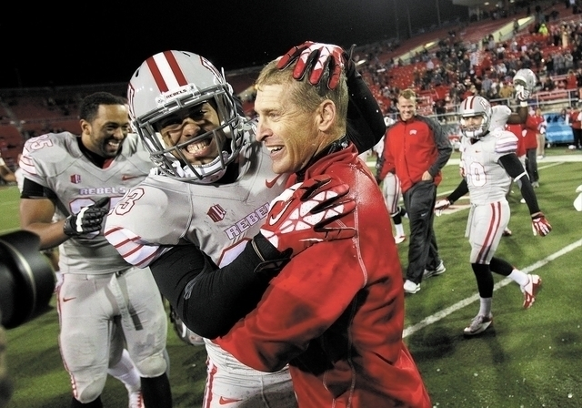 UNLV head coach Bobby Hauck celebrates a victory with one of his players (File/Las Vegas Review-Journal)