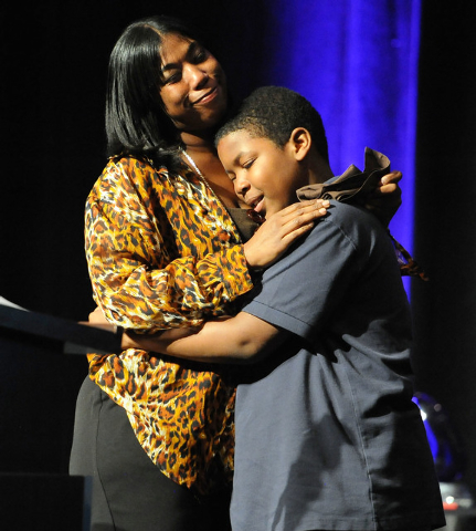 Alisha Smith hugs her son, Ahmad, 10, at the Catholic Charities of Southern Nevada 73rd anniversary celebration Heart of Hope awards ceremony at the Red Rock Resort hotel-casino in Las Vegas, Frid ...