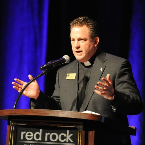Deacon Tom Roberts, president and chief operation officer of Catholic Charities of Southern Nevada makes opening comments at the 73rd anniversary celebration Heart of Hope awards ceremony at the R ...