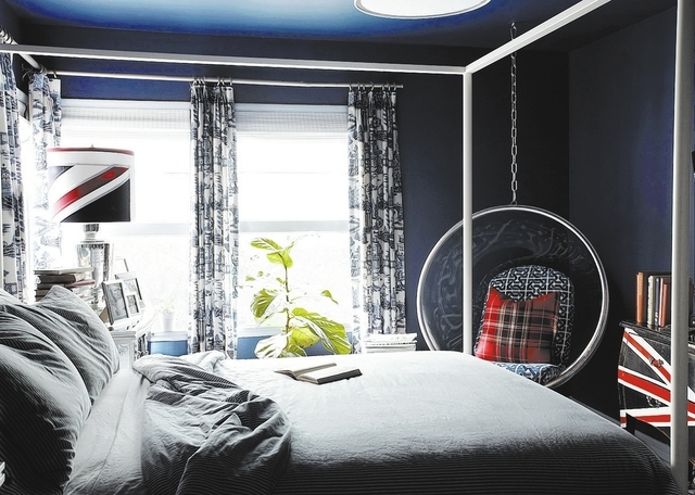 This photo provided by Brian Patrick Flynn shows how the designer Flynn layered his windows with black-out shades from Texton and custom drapery panels lined with blackout liner in his own bedroom ...