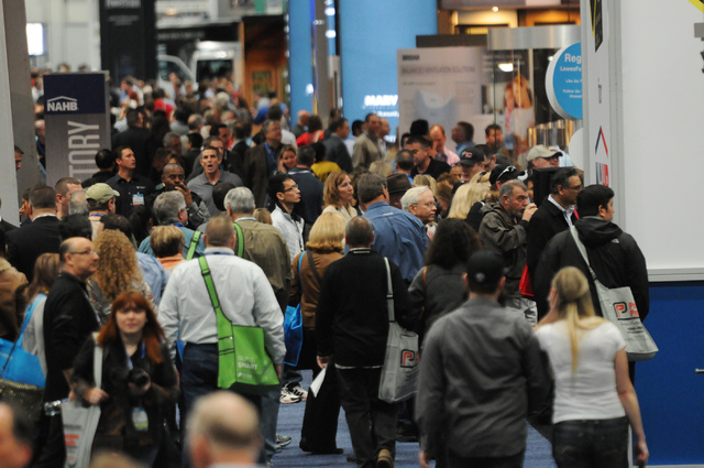 Visitors are seen at the International Builders' Show at the Las Vegas Convention Center on Wednesday. The International Builders' Show is running with the Kitchen & Bath Industry Show for the fir ...