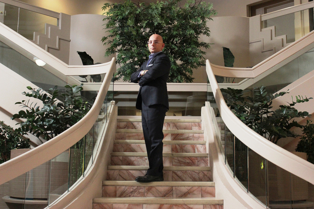 """Anthony Melchiorri poses on the staircase at the Fortune Hotel in Travel Channel's """"Hotel Impossible."""" credit Travel Channel"""