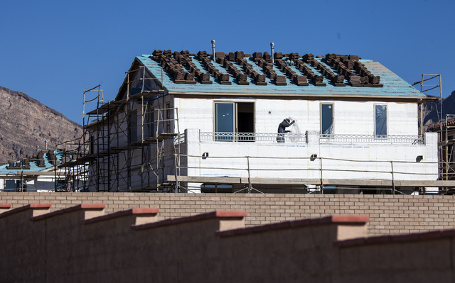 Construction in the Paseo community at Summerlin is seen Tuesday, Feb. 25, 2014. Home price fell in December according to the latest Standard & Poorճ/Case-Shiller 20-city home price index. Las Ve ...