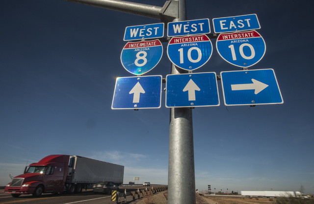 Signs at Exit 200 between Casa Grande, Ariz. and Eloy, Ariz. as seen Tuesday, Nov. 19, 2013 . Nevada and Arizona lawmakers and businessmen are supporting a proposal create a new interstate to conn ...