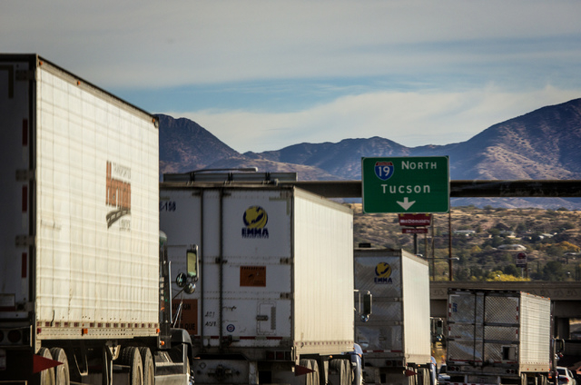 Trucks prepare to head north after crossing the DeConcini Port of Entry at Nogales, Arizona Wednesday, Nov. 20, 2013. Nevada and Arizona lawmakers and businessmen are supporting a proposal create  ...