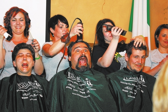 Alex Raffi, center, get his head shaved with fellow teammates at a St. Baldrick's Day event in March 2011 at McMullan's Irish Pub. (Las Vegas Review-Journal file)