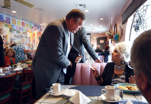 Assemblyman Cresent Hardy, R-District 19, greets Patricia Martinelli-Price at the Hispanics in Politics at Dona Maria Tamales restaurant in Las Vegas on Wednesday. Hardy is running in the Congress ...