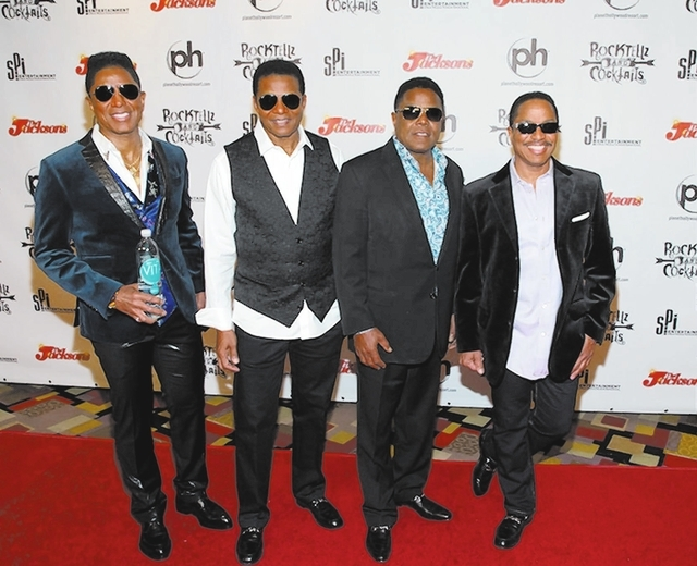 "Jermaine, Jackie, Tito and Marlon Jackson are back on the Las Vegas Strip for the first time decades in ""RockTellz & Cocktails"" at Planet Hollywood Resort. They were on the red carpet Saturday for ..."