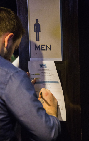 Chris McLune fill out a job applicationduring a job fair for Rehab at the Hard Rock Hotel & Casino on Monday, Jan. 27, 2014.  (Jeff Scheid/Las Vegas Review-Journal)