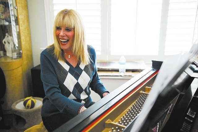 "Linda November plays piano during an interview with the Review-Journal at her home in Henderson on Thursday, Jan. 16, 2014. November has sung thousands of commercial jingles, such as the ""Cok ..."