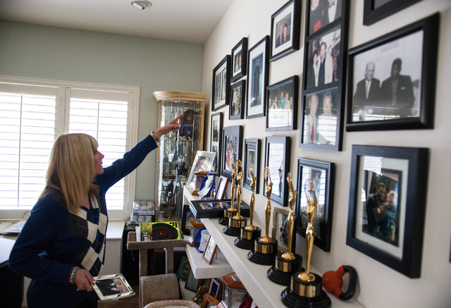 Linda November points out various photos of friends and family during an interview with the Review-Journal at her home in Henderson on Thursday, Jan. 16, 2014. November has sung thousands of comme ...