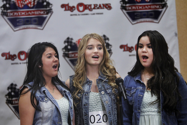 Members of Sugarstack, from left, Malia Olds, Siena Paglia, and Cat Rian perform for the judges while auditioning to earn the opportunity to sing the National Anthem before the start of the upcomi ...