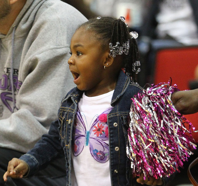 Peyton Haynes-Kennedy cheers for her mom, UNLV's Rmanii Haynes, before the Lady Rebels take on Utah State at the Cox Pavilion in Las Vegas on Saturday. (Chase Stevens/Las Vegas Review-Journal)