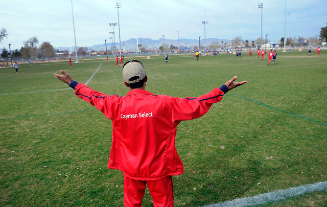 Cayman Select 14 and under coach Ernie Seymour calls to his team during a match against the Cook Inlet Soccer Club from Anchorage, Alaska at Ed Fountain Park on Saturday, Feb. 15, 2014. (David Bec ...