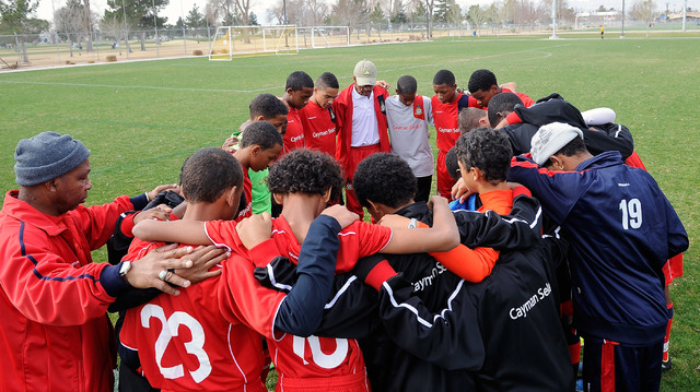 The Cayman Islands' Cayman Select 14 and under team gather for a pre game moment before their match against the Cook Inlet Soccer Club from Anchorage, Alaska at Ed Fountain Park on Saturday, Feb.  ...