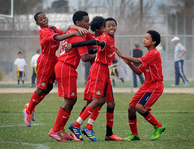 Cayman Select from left, D'Andre Rowe, Cody Ebanks, Ricardo Damasso, Trey Ebanks and Francisco Murillo-Johnson Jr. celebrate after Cody Ebanks scored the go ahead goal against Cook Inlet Soccer Cl ...