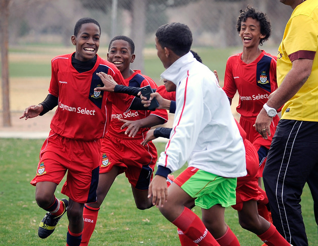 Cayman Select's Kareem Foster, left, celebrates with his team after scoring a goal against Cook Inlet Soccer Club during their 14 and under soccer match at Ed Fountain Park on Saturday, Feb. 15, 2 ...