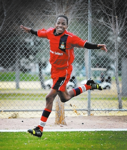 Cayman Select's Kareem Foster celebrates after scoring a goal against Cook Inlet Soccer Club during a 14 and under soccer match at Ed Fountain Park on Saturday, Feb. 15, 2014. Cayman won 3-1. (Dav ...