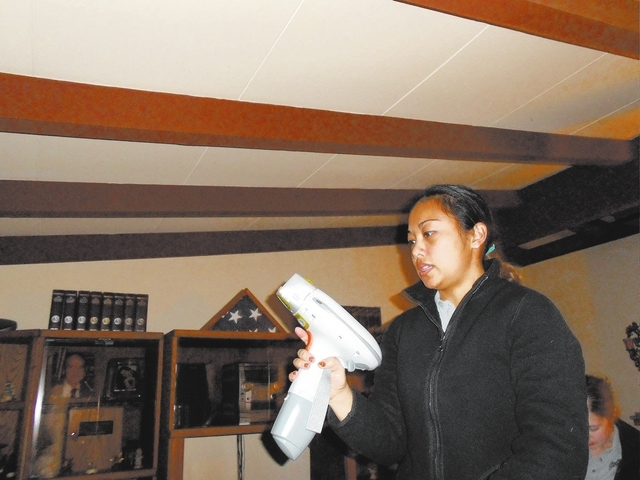 Michelle Ching, a healthy home specialist, uses an X-ray fluorescence machine to test for lead in a Henderson home. The test is part of UNLV's program to see if older homes in the area have lead.  ...