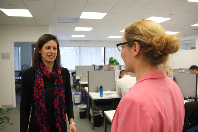 King & Bishop Inc.'s Leto Papadopoulos, left, director of training and development, speaks with sourcing specialist Victoria Majcher about subtle changes that can lead to job offers. The HR and  ...