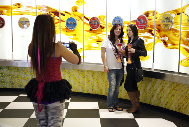 Christa Johnston, right, and Elissa Cunningham have their picture taken by Jan Acero in the Purple Zebra at The Linq in Las Vegas Tuesday, Feb. 11, 2014. (John Locher/Las Vegas Review-Journal)