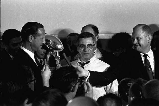 Football commissioner Pete Rozelle, left, presents the trophy to Coach Vince Lombardi of the Green Bay Packers in Los Angeles January 15, 1967, after the Packers trounced the Kansas City Chiefs 35 ...