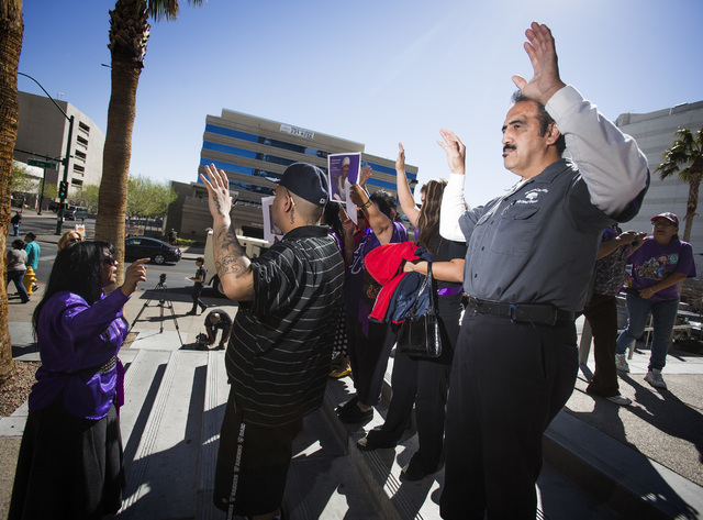 Victor Ortiz, right, brother of domestic violence victim Maria Del Carmen Gomez, is shown during a domestic violence demonstration outside Clark County District Court on Monday. About 15 people ra ...