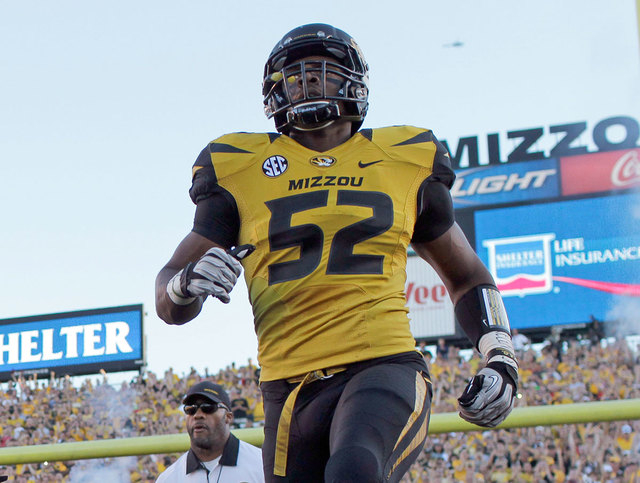 Missouri's Michael Sam runs onto the field before the start of a 2012 football game against Georgia in Columbia, Mo. Sam, Missouri's All-America defensive end, announced Sunday that he is gay. He  ...