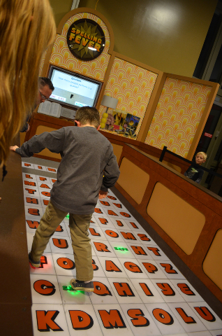 A visitor takes on the Spelling Fever challenge at the Children's Discovery Museum's visiting Mindbender Mansion exhibit, Feb. 2014. (Ginger Meurer/View)