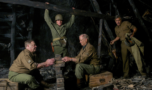 "(l to r) Walter Garfield (JOHN GOODMAN), James Granger (MATT DAMON), Richard Campbell (BILL MURRAY), and Frank Stokes (GEORGE CLOONEY) work to put weight on a ""booby trap"" that James Gra ..."
